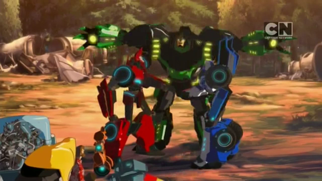Grimlock and his pals. (Pilot (Part 2) - S01E02 of Transformers: Robots in Disguise)