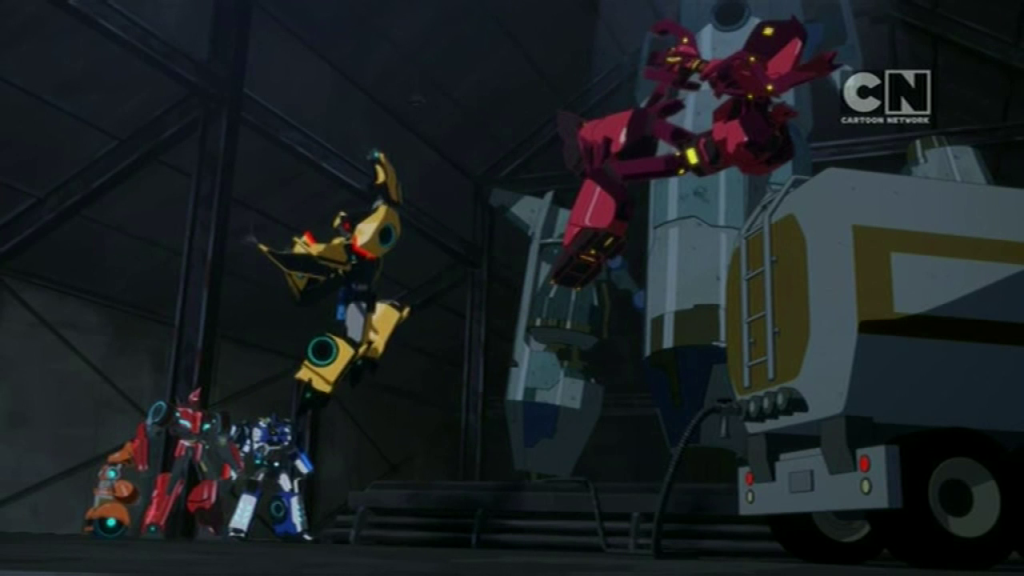 "Bumblebee uppercuts Chop Shop into oblivion. (""More than Meets the Eye"" S01E04 of Transformers: Robots in Disguise)"