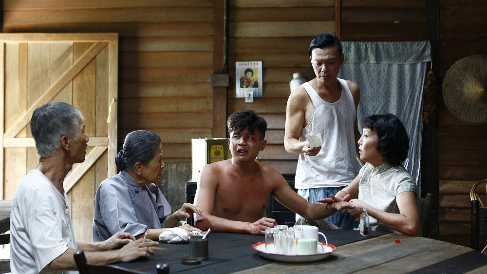 Fourth Uncle (Wang Lei), Ah Ma (Ng Suan Loi), Ah Xi (Benjamin Tan), Ah Kun (Mark Lee) and Zhao Di (Aileen Tan) recuperate after a fight. (Golden Village Pictures)