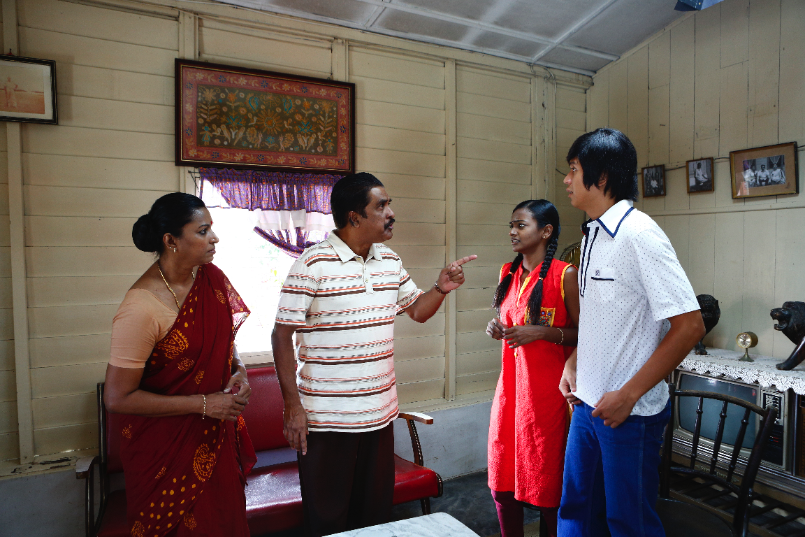 "Shamugen (Silvarajoo Prakasam) and his wife confront Rani and Ah Hee in ""Long Long Time Ago 2."" (Golden Village Pictures)"
