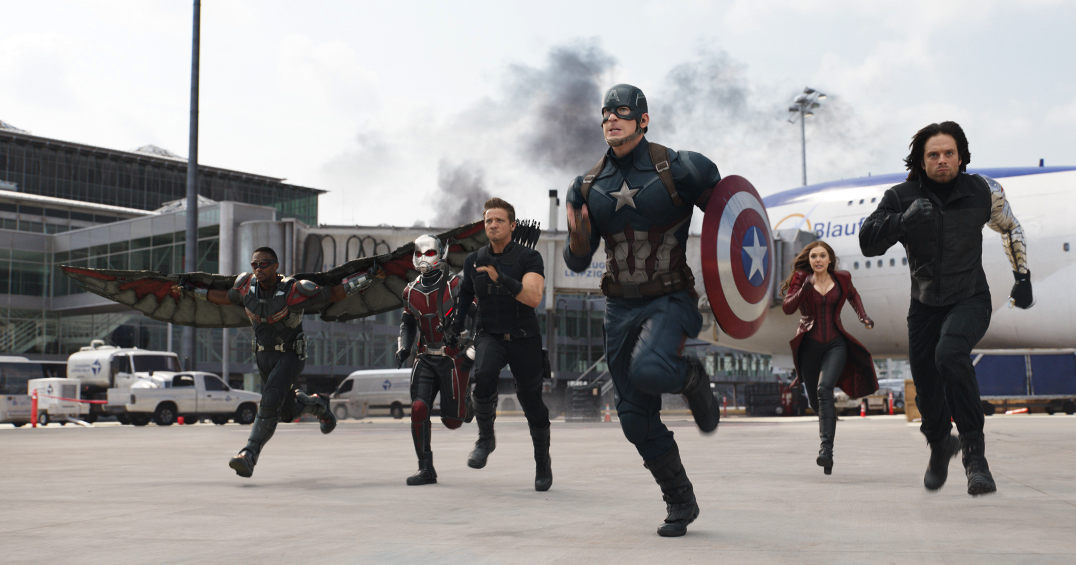 "Captain America (Chris Evans) leads Winter Soldier (Sebastian Stan), Scarlet Witch (Elizabeth Olsen), Hawkeye (Jeremy Renner), Ant-Man (Paul Rudd), and Falcon (Anthony Mackie) into battle in ""Captain America: Civil War."" (Walt Disney Pictures)"