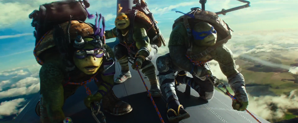 "Donatello, Michelangelo, and Leonardo in the air in ""Teenage Mutant Ninja Turtles: Out of the Shadows"" (United International Pictures)"