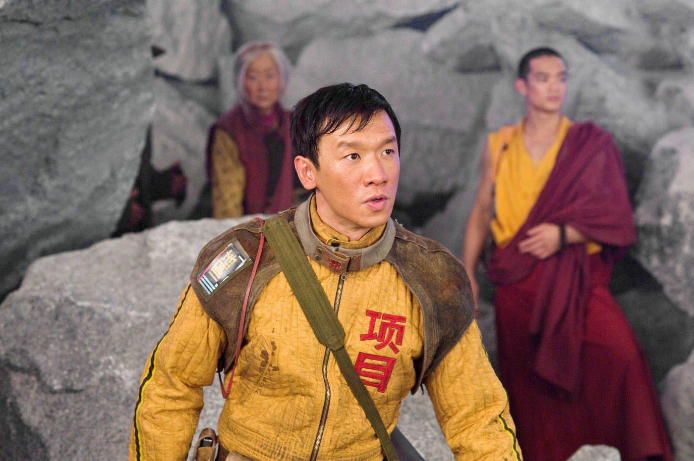 "Chin Han as Tenzin in ""2012."" (Ace Showbiz)"