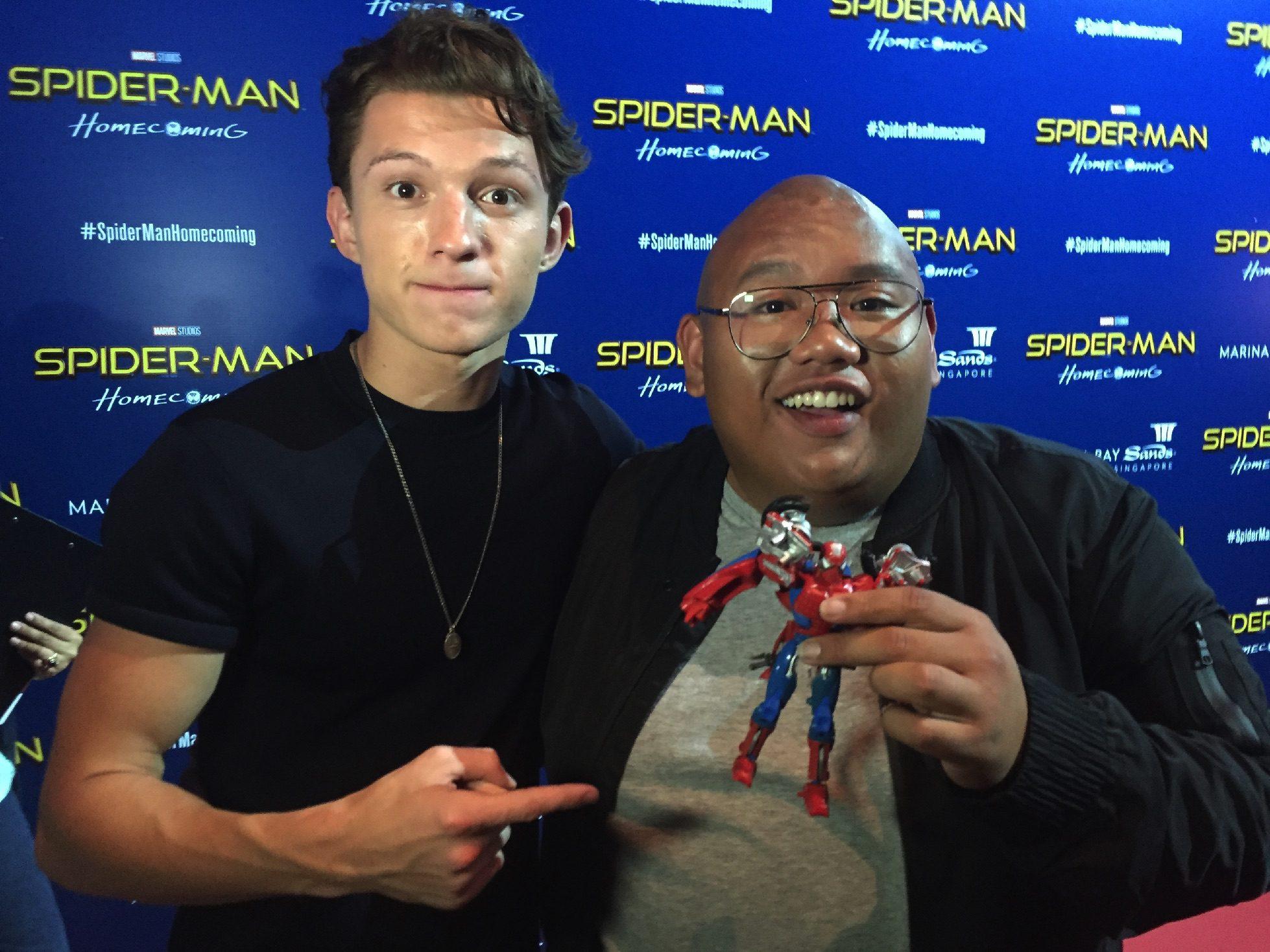 Tom Holland and Jacob Batalon and a Spider-Man Transformer.
