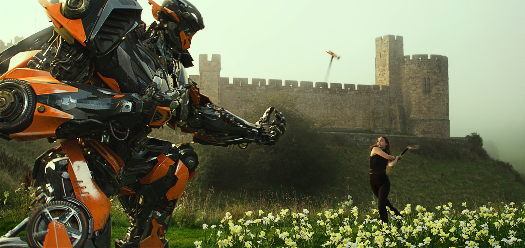 "Hot Rod frightens Viviane (Laura Haddock) in ""Transformers: The Last Knight"". (United International Pictures)"