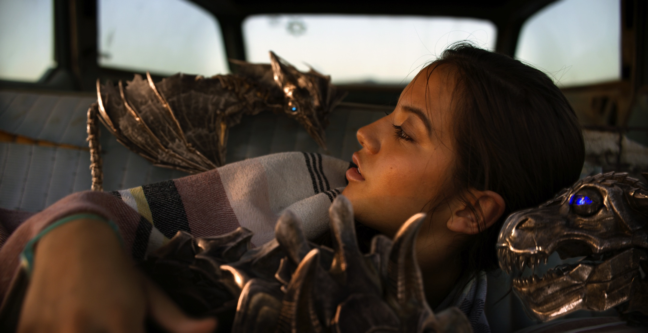 "Izabella (Isabela Moner) and the mini-Dinobots in ""Transformers: The Last Knight"". (United International Pictures)"