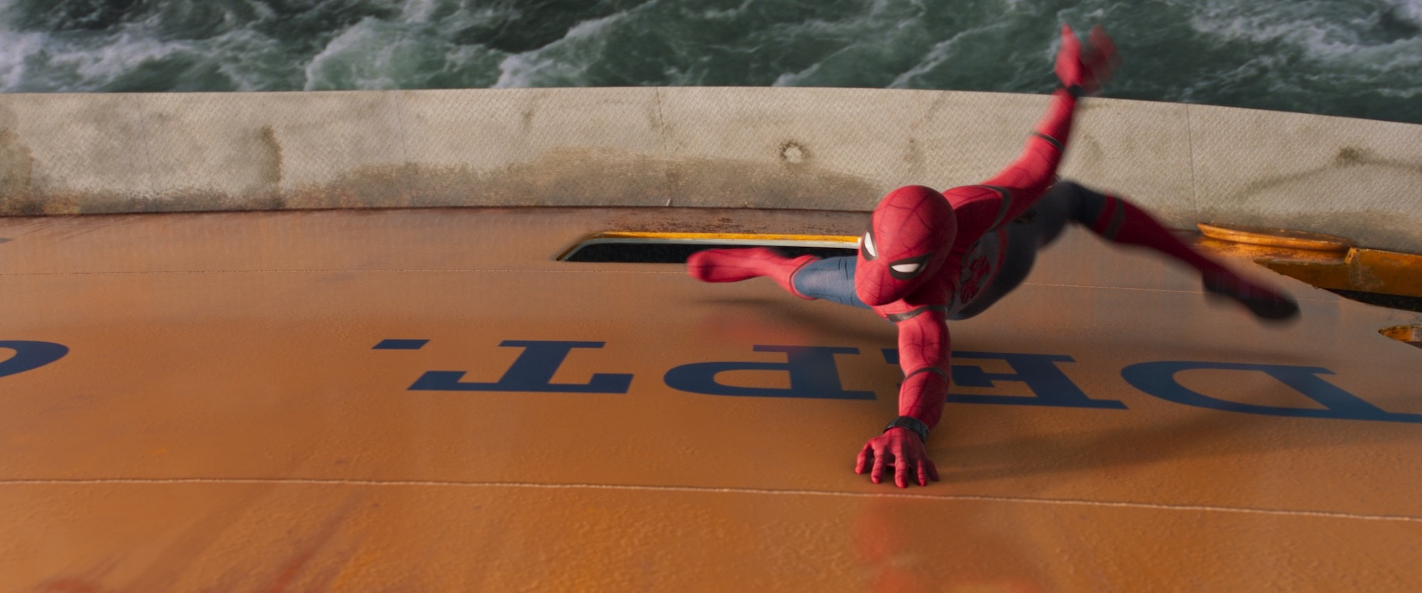 "Spider-Man grabs on to the Staten Island Ferry in a last ditch effort to save it from sinking in ""Spider-Man: Homecoming"". (Sony Pictures Releasing)"