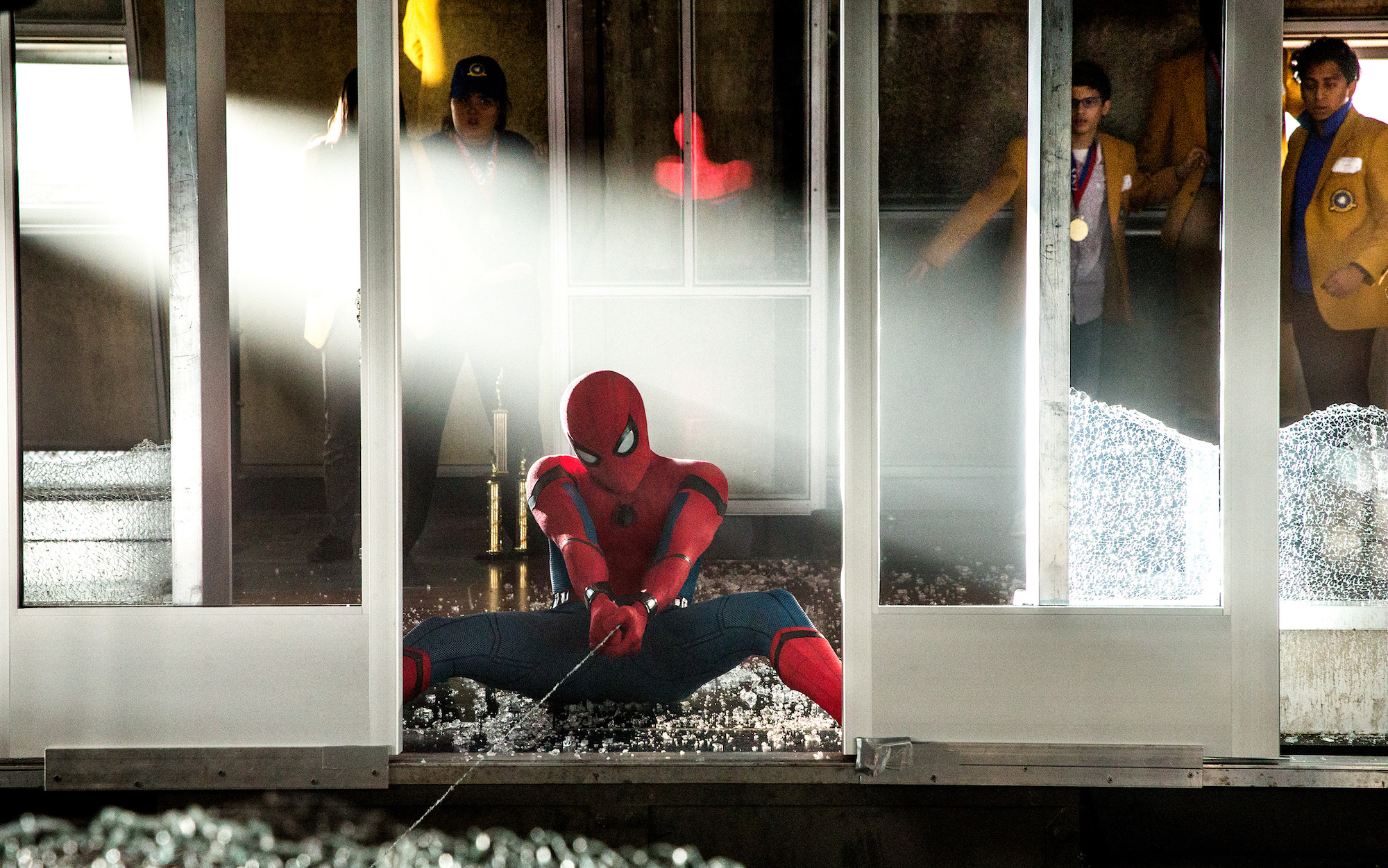 "Spider-Man (Tom Holland) works to stop the elevator from falling in ""Spider-Man: Homecoming"". (Sony Pictures Releasing)"