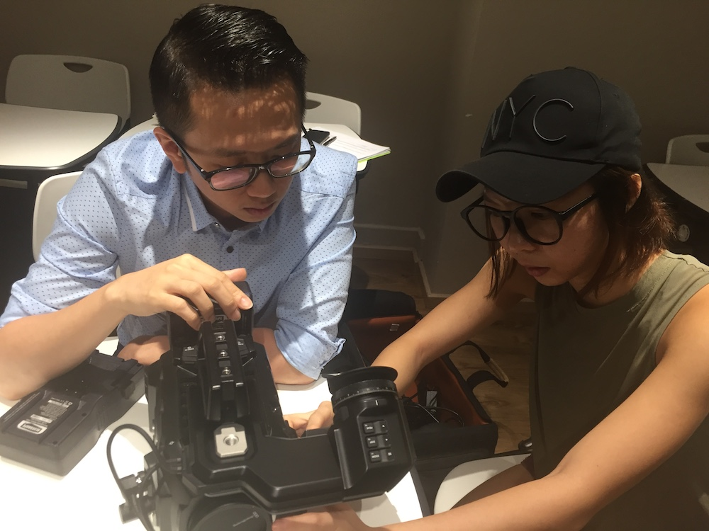 Charmaine (Producer) and Jian Hui (Director of Photography) test... some thing important.
