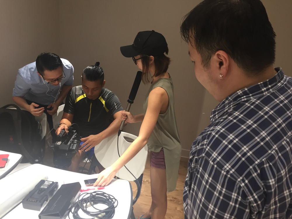 Wee Han (Technical Consultant), Charmaine (Producer), Jian Hui (Director of Photography) testing out the boom mike while I use eye power to assist.