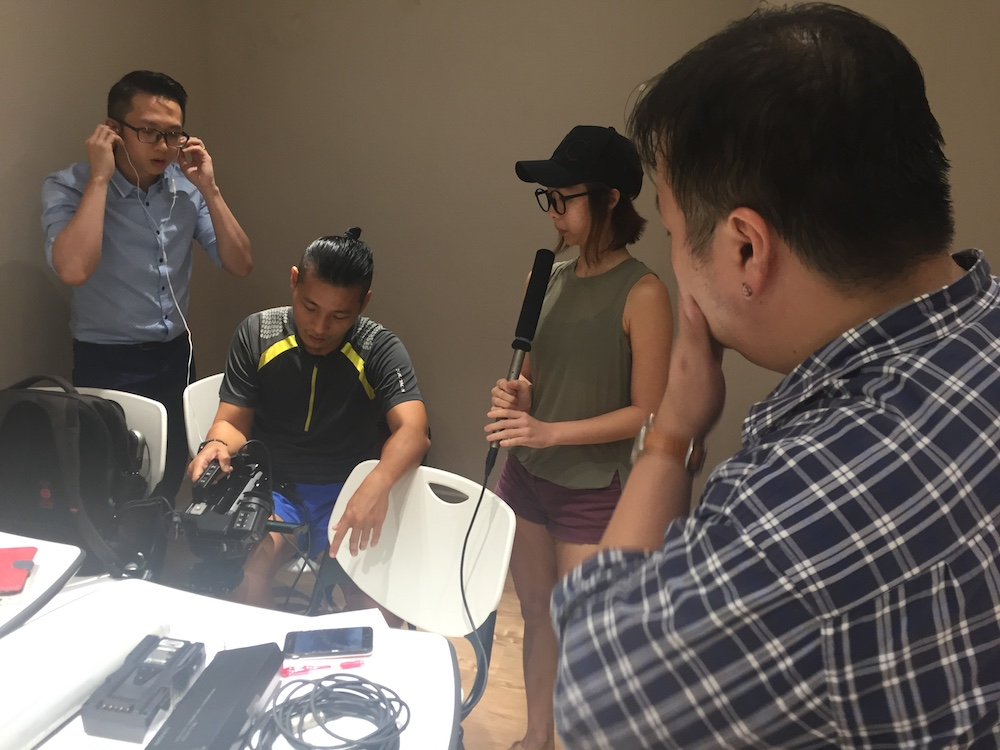 Wee Han (Technical Consultant), Charmaine (Producer), Jian Hui (Director of Photography) doing real work while I just giggle in the background.Wee Han (Technical Consultant), Charmaine (Producer), Jian Hui (Director of Photography) doing real work while I just giggle in the background.
