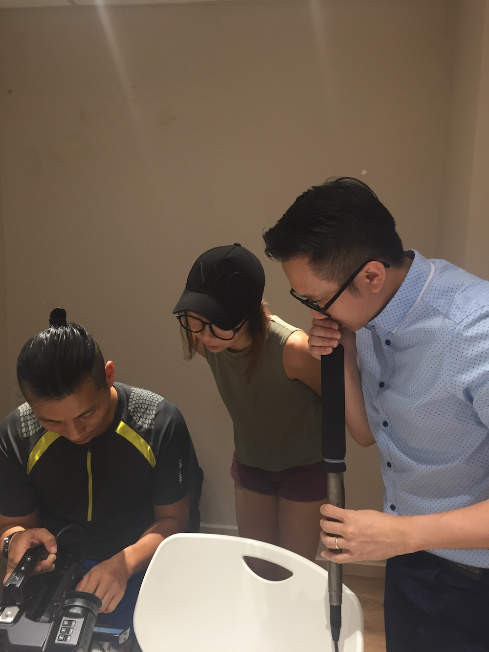 Wee Han (Technical Consultant), Charmaine (Producer), Jian Hui (Director of Photography) tinkering with the Ursa Mini Pro.