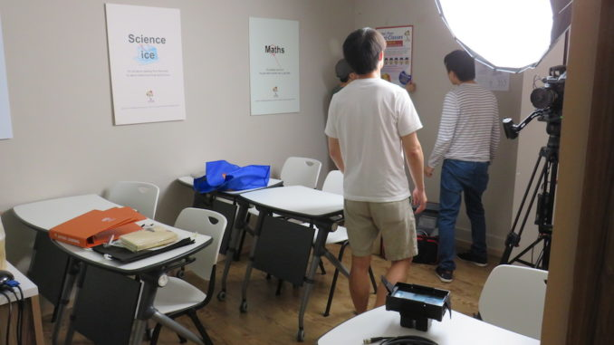 Jian Hui, Adrian, and Wilson checking out our setup.