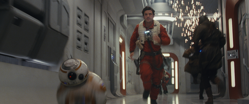 """BB-8 and Poe Dameron (Oscar Isaac) in """"Star Wars: The Last Jedi"""" (Walt Disney Pictures)"""