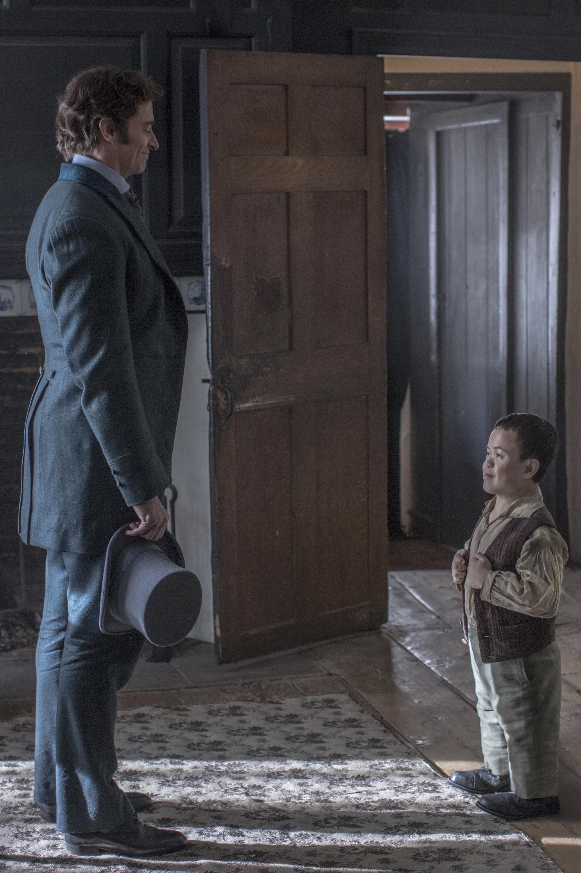"Hugh Jackman, left, and Sam Humphrey star in Twentieth Century Fox's ""The Greatest Showman."""